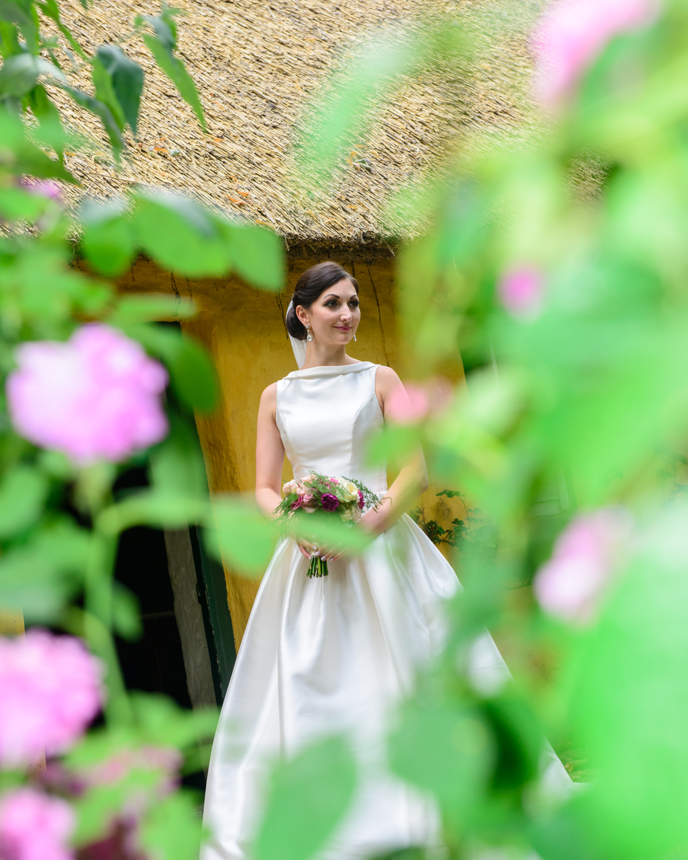 bride through the flowers at Bunratty Folk Park
